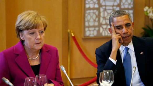 U.S. President Barack Obama and German Chancellor Angela Merkel listen during the G7 Summit working dinner in Brussels