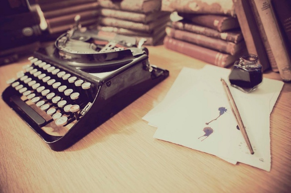 old typewriter and books