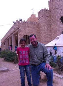 Seiple with young Christan girl in Iraq