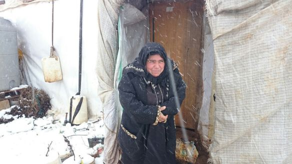 woman refugee caught in snow